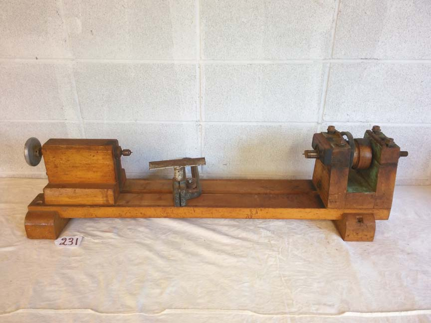 #231 Antique Wooden Lathe - $250